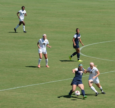 Missouri's Kaysie Clark (9, in white) fights for possession against Alyssa Curtis (9) of UT-Martin as Erin Webb (4), Melanie Donaldson (10) and Rianna Jarrett (11) look on during the Tigers' matchup with the Skyhawks on Sunday, Sept. 7, 2014. Clark had a key pass in the match that led to Missouri's only goal. (Tim Leible)