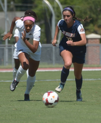 Missouri's Jessica Johnson (left) races Taylor Fry of Tennessee-Martin during the Tigers' matchup with the Skyhawks on Sunday, Sept. 7, 2014, at Walton Stadium in Columbia, Missouri. Johnson had two of the Tigers' nine shots on goal in the match. (Greg Dailey)