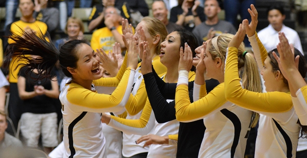 Sophomore outside hitter Carly Kan high fives her teammates during her introduction in Missouri's matchup against Oakland on Saturday, Sept. 6, 2014.