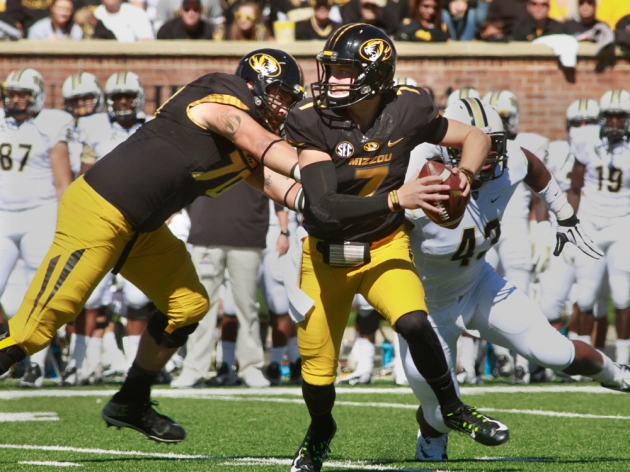 Missouri quarterback Maty Mauk (7) scrambles out of the pocket as offensive lineman Anthony Gatti (70) blocks Central Florida's Deondre Barnett (43) on Saturday, Sept. 13, 2014 in Columbia. (Karen Mitchell, KBIA Sports)