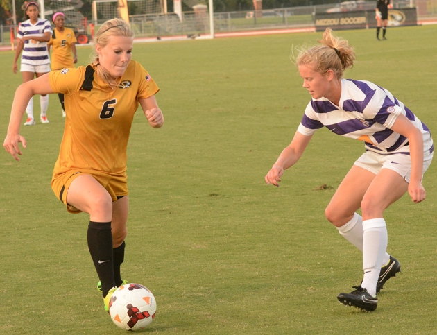 Missouri's Reagan Russell (6) dribbles by Louisiana State's Megan Lee (13) as Summer Clarke (4, in white) and Brittany Conley (5, in gold) watch the action on Friday, Sept.19, 2014 at Walton Stadium in Columbia, Missouri. Russell scored two goals (51st, 90th) in Missouri's 3-1 victory over LSU.