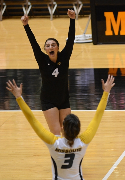 Libero Sarah Meister (4) celebrates winning a point with setter Loxley Keala. Meister had 16 digs in the match.
