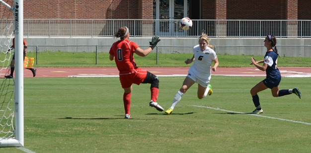 Missouri's Reagan Russell (6) hits a header past UT-Martin goalie Mariah Klenke (0) as Taylor Fry attempts to make a defensive stop during the Tigers' 1-0 win over Tennessee-Martin on Sunday, Sept. 7, 2014, at Walton Stadium in Columbia, Missouri. Russell scored the lone goal of the match. (Tim Leible)