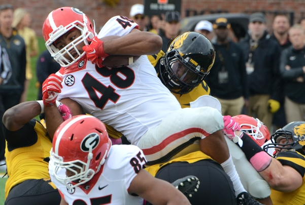 The Missouri defense collapses on Georgia tight end/running back Quayvon Hicks (48). Georgia had 58 carries for 210 yards and three touchdowns against the Tigers on Saturday, Oct. 12, 2014 at Faurot Field.