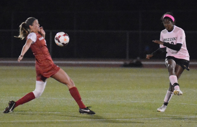 Missouri's Candace Johnson (23) clears a ball away from Arkansas forward Alexandra Fischer (11) during the Tigers' 2-1 victory over the Razorbacks Thursday, Oct. 30, 2014 at Walton Stadium in Columbia, Missouri. Johnson and the Missouri defense limited Arkansas to just three shots on goal.