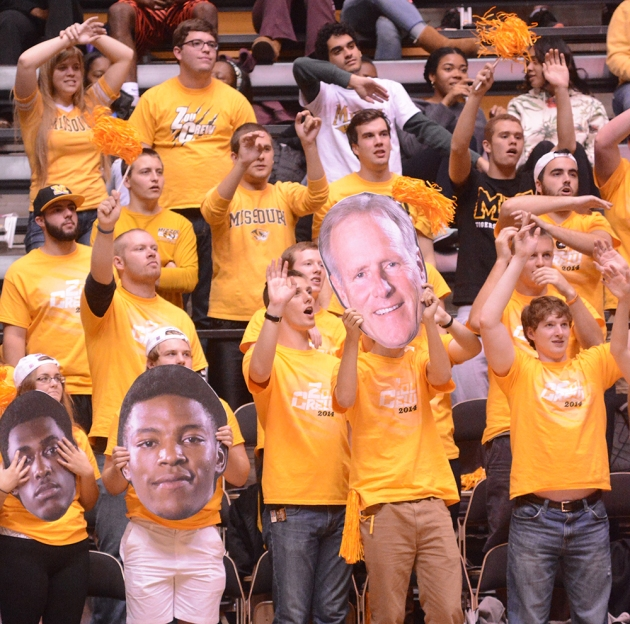 Missouri fans taunt William Jewell and hold up cut outs of Kim Anderson, Wes Clark  and Montaque Gill-Caesar during a free throw attempt.