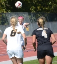 Missouri's Lauren Flynn (11, hidden) throws the ball in to teammate Reagan Russell (6), as Vanderbilt's Taylor Richardson guards Russell closely. Flynn and the Missouri defense allowed 5 shots on goal by the Commodores.