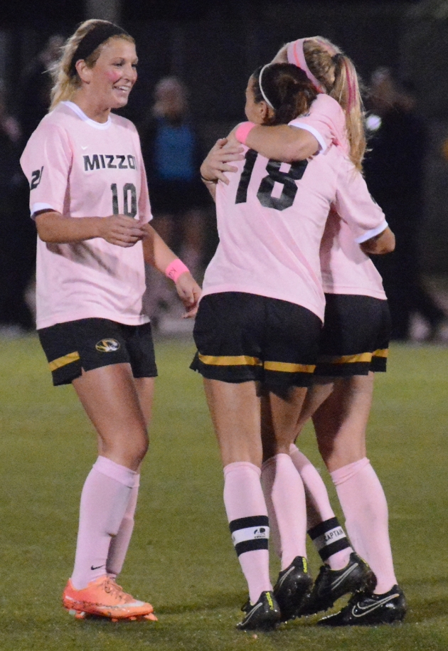 Missouri's Kaysie Clark (9, hidden) and Melanie Donaldson (10) congratulate teammate Taylor Grant (18) after Grant's goal in the 28th minute. Grant's strike was her seventh goal of the season, and the assist from Clark was her 10th on the year.