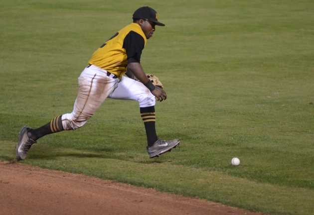 Second baseman Jerry Houston runs after a botched groundball on Friday, Oct. 24, 2014.