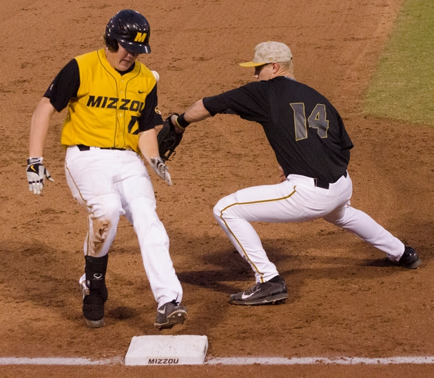 Josh Lester (17) reaches third safely on a triple on Friday, Oct. 24, 2014. Third baseman Zach Lavy (14) attempts to make a play, but was unable to come up with the throw.