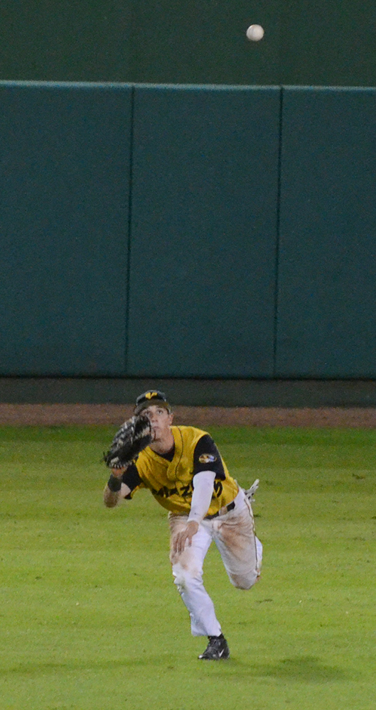 Sophomore Jake Ring makes a diving catch in centerfield on Thursday, Oct. 16, 2014.