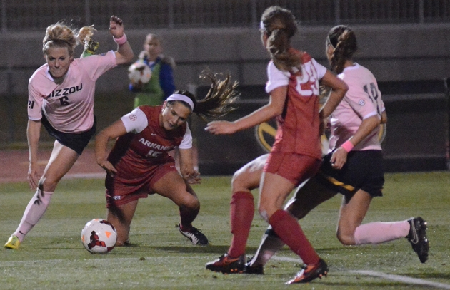 Missouri's Reagan Russell  tries to maneuver around Arkansas' Jessi Hartzler as Razorback defender Hannah Neece and Tiger forward Taylor Grant pursue in the second half. A foul was called on Russell, but she and the Tigers rebounded to score the game-winning goal in the 74th minute.