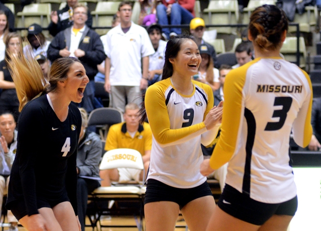 Sarah Meister (4) and Carly Kan (9) celebrate winning a point in the second set.