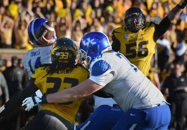 Missouri defensive end Shane Ray (56) jumps to knock down Kentucky quarterback Patrick Towles' (14) pass at the line of scrimmage. Missouri defensive end Markus Golden (33) applies pressure to the quarterback after beating Kentucky offensive tackle Jordan Swindle (70) around the edge.
