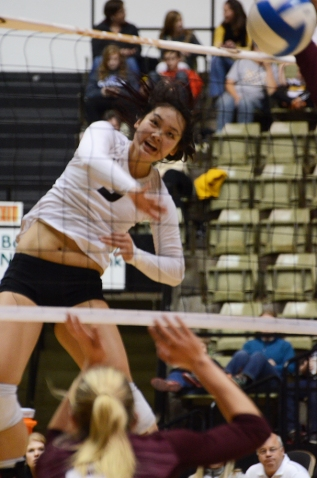 Outside hitter Carly Kan jumps to kill a ball in the fourth set. Kan had a team-high of 12 kills with a .195 hitting percentage in the match.