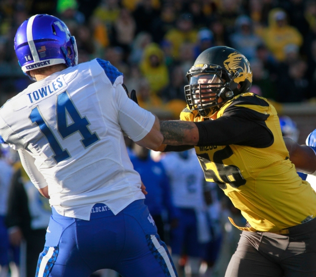 Kentucky quarterback Patrick Towles (14) is pressured by Missouri's Shane Ray on Saturday, Nov. 1, 2014. Ray shacked Towles twice in the 20-10 Missouri win and on Monday was named SEC defensive player of the week. Ray now holds the single season record for sacks with 12. The old record was 11.5. Photo by Karen Mitchell