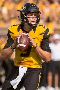 Missouri quarterback Drew Lock looks for a receiver during the second quarter. (AP Photo/L.G. Patterson)