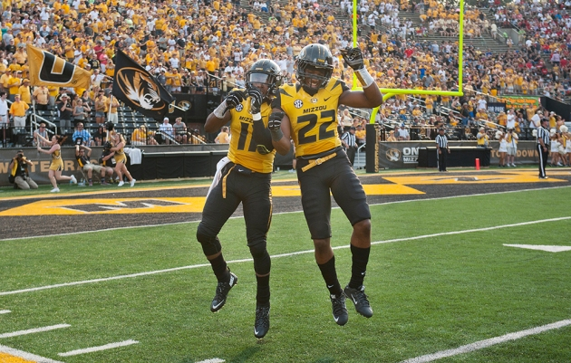 Missouri's Aarion Penton, left, celebrates with teammate Anthony Sherrils after Penton scored a touchdown during the third quarter of Saturday's game against Southeast Missouri State. (AP Photo/L.G. Patterson)